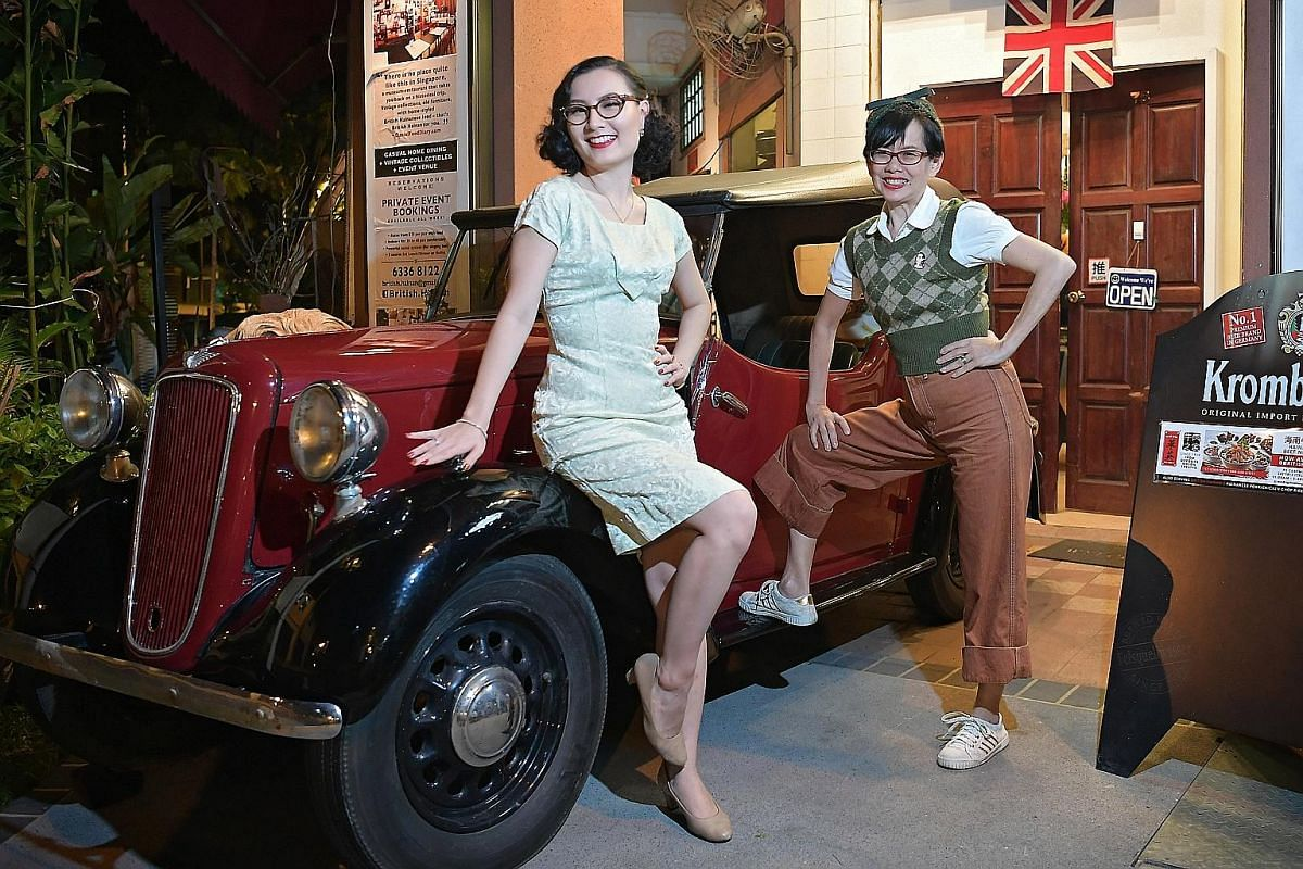 """A gathering of vintage lovers in retro-style restaurant British Hainan in Joo Chiat - (from far left) singer Lou Peixin, who bills her music as """"classic vintage pop"""", and lindy hop dancer Lim Sing Yuen. Left: Ms Gwen Heng in an early 1960s-style dres"""