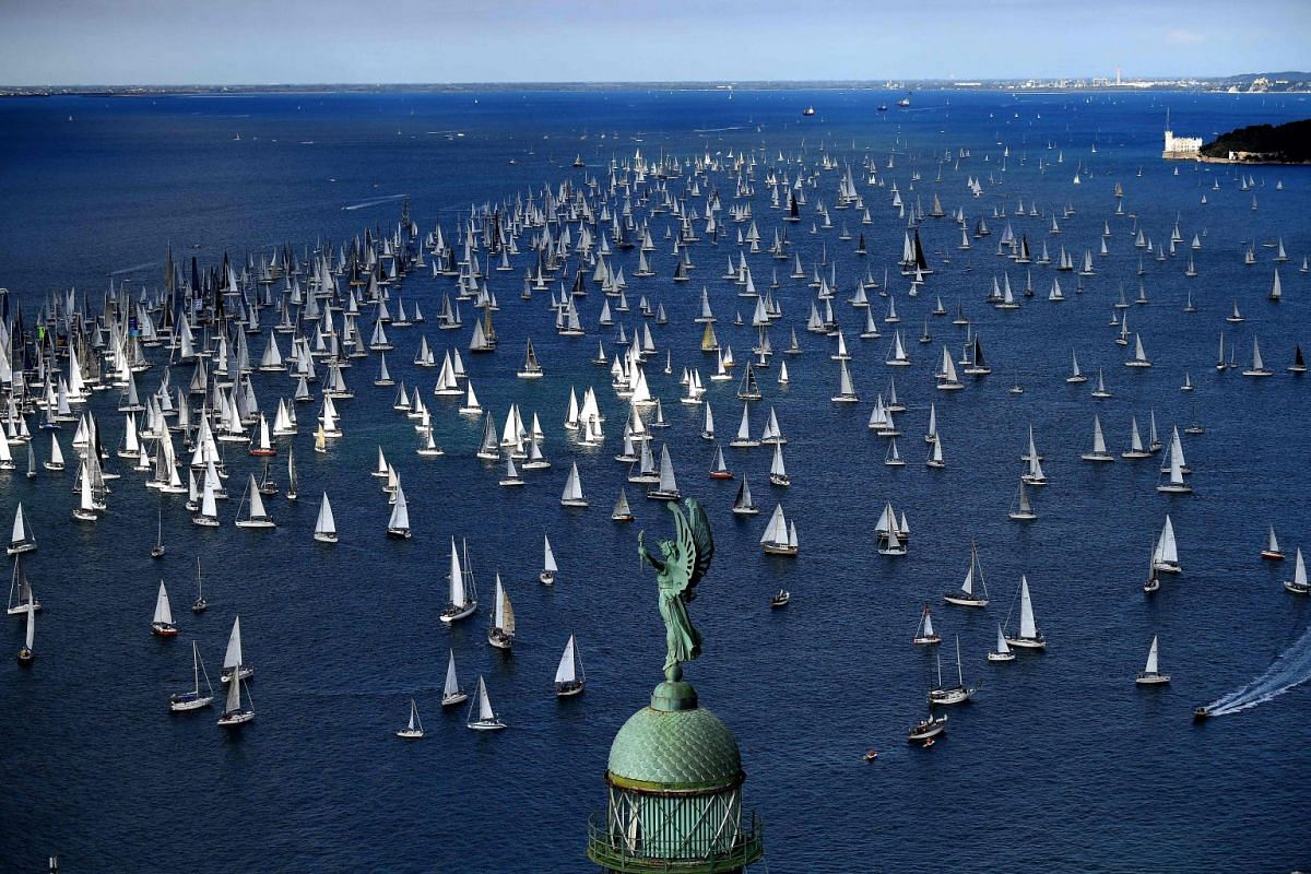 Boats sail past the Victory Lighthouse during the 49th Barcolana regatta in the Gulf of Trieste, on Oct 8, 2017. PHOTO: AFP