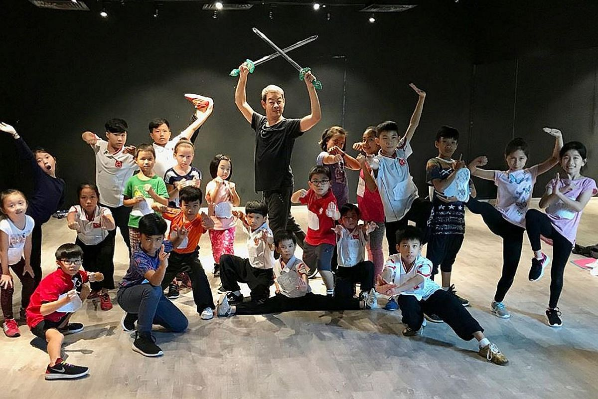 Theatre veteran Ivan Heng with children who appear in Mama White Snake by Wild Rice.