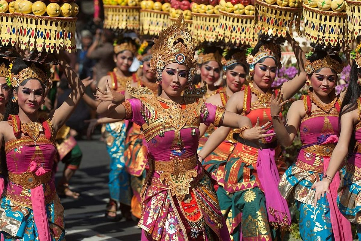Komodo National Park at Labuan Bajo is a Unesco heritage site. Visitors to Lake Toba (main picture), which sits 900m above sea level, can enjoy a cooler climate. Dance is an integral part of Bali's culture, and traditional performances are a must-see