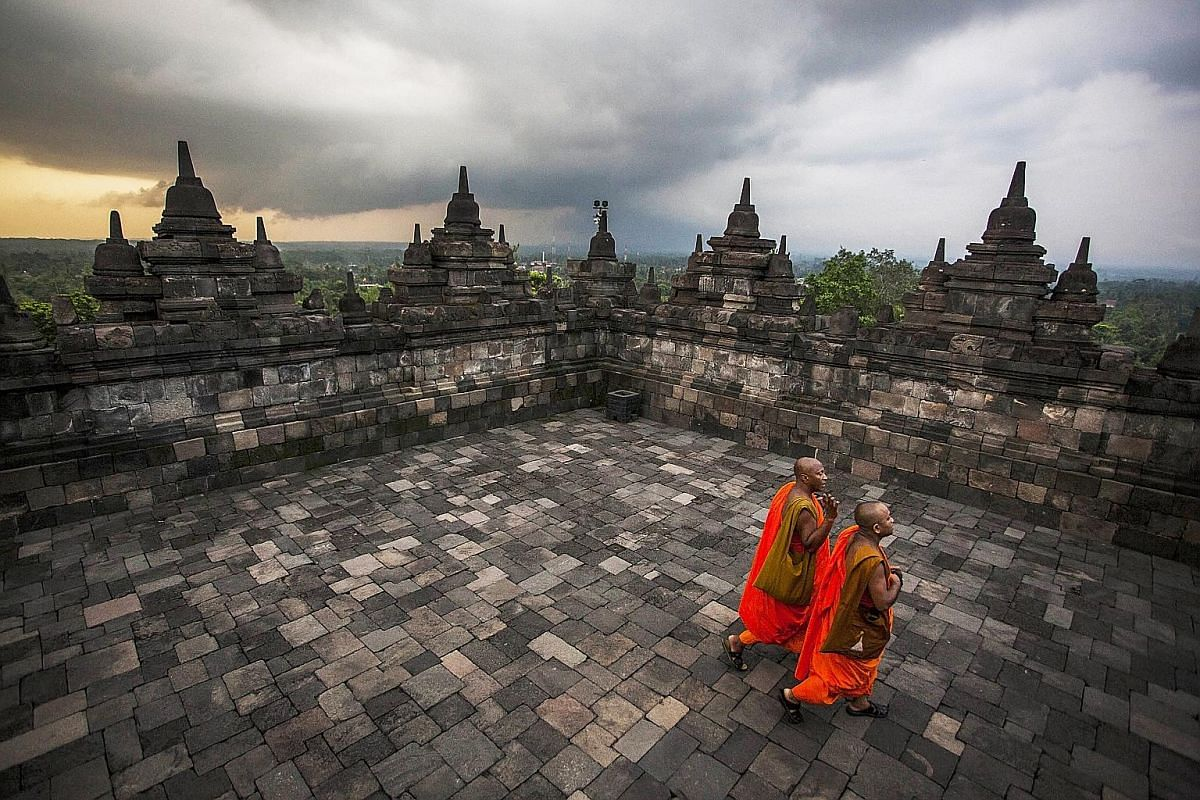 Buddhist monks at Borobudur Temple in Central Java during Vesak Day celebrations, usually held in May or June.