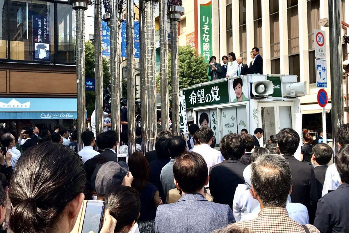 A crowd gathering in front of a shopping street to listen to Ms Koike stump for Party of Hope candidate Kaoru Matsuzawa, a lawyer, at the upmarket district of Azabujuban on Oct 10, 2017.