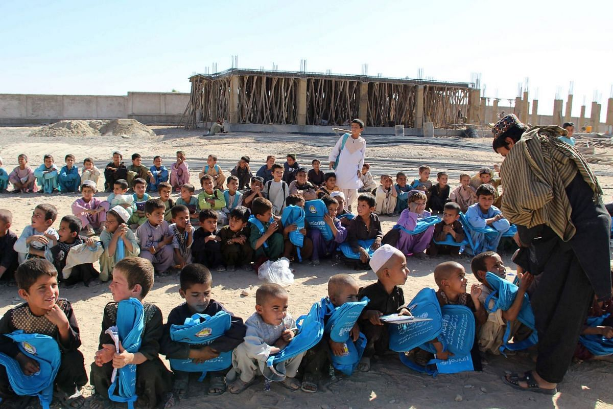 Afghan boys receive bags and pens from UNICEF in Helmand province, Afghanistan, Oct 8, 2017.  PHOTO: AFP