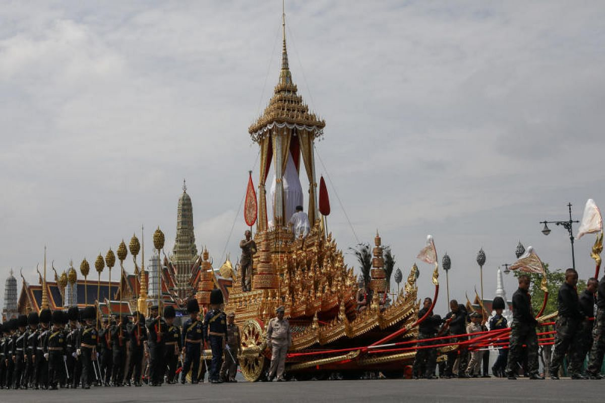 Officers of the Thai army and royal officials take part in a funeral rehearsal near the Grand Palace in Bangkok.