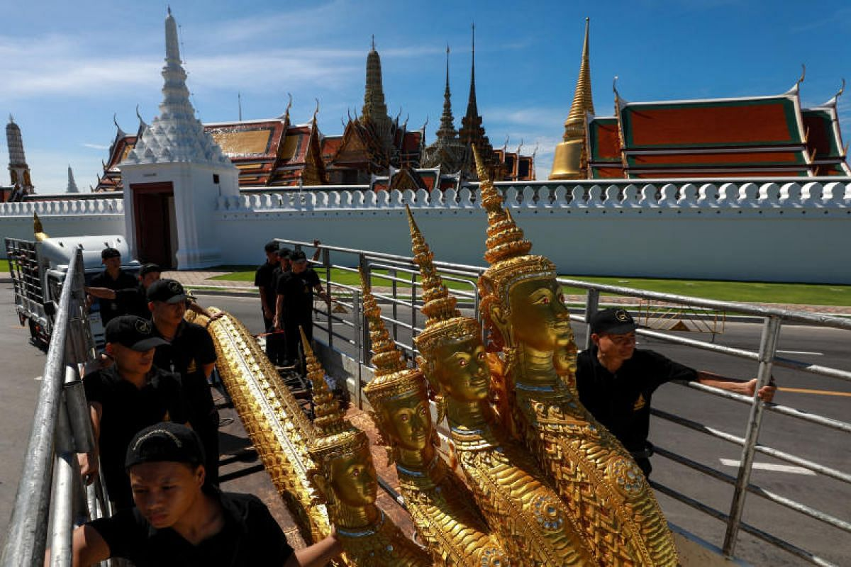 Workers moving sculptures of deities, which will be used in the cremation ceremony for the late King Bhumibol Adulyadej in Bangkok, Thailand.