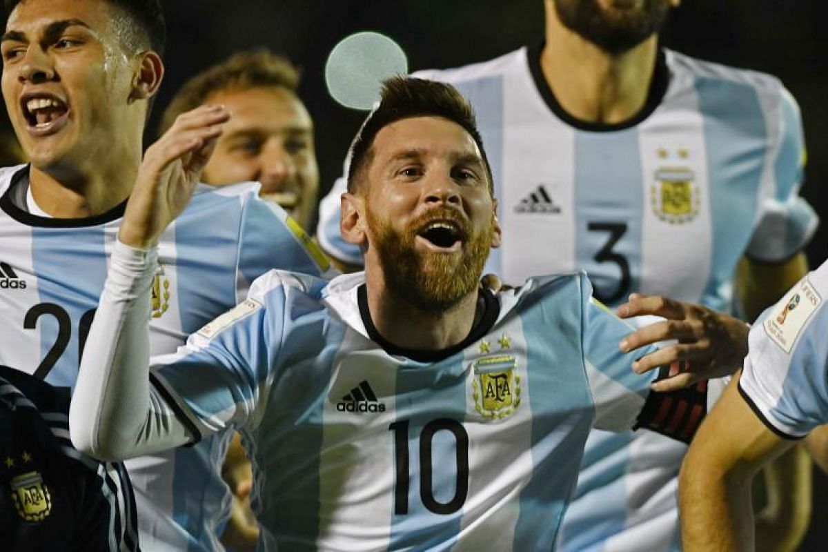 Argentina star Lionel Messi (centre) celebrating after his hat-trick helped defeat Ecuador 3-1 in Quito to earn his country qualification to the World Cup.