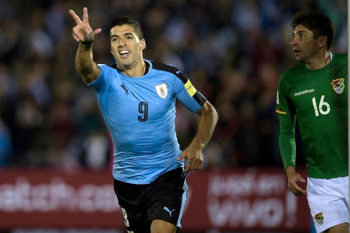 Uruguay's Luis Suarez celebrating after scoring his second goal against Bolivia during their World Cup qualifier match in Montevideo. Uruguay won 4-2.