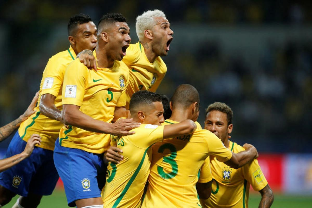 Brazil players celebrating their opening goal against Chile. They won 3-0, ending the South American champions bid to qualify for Russia.