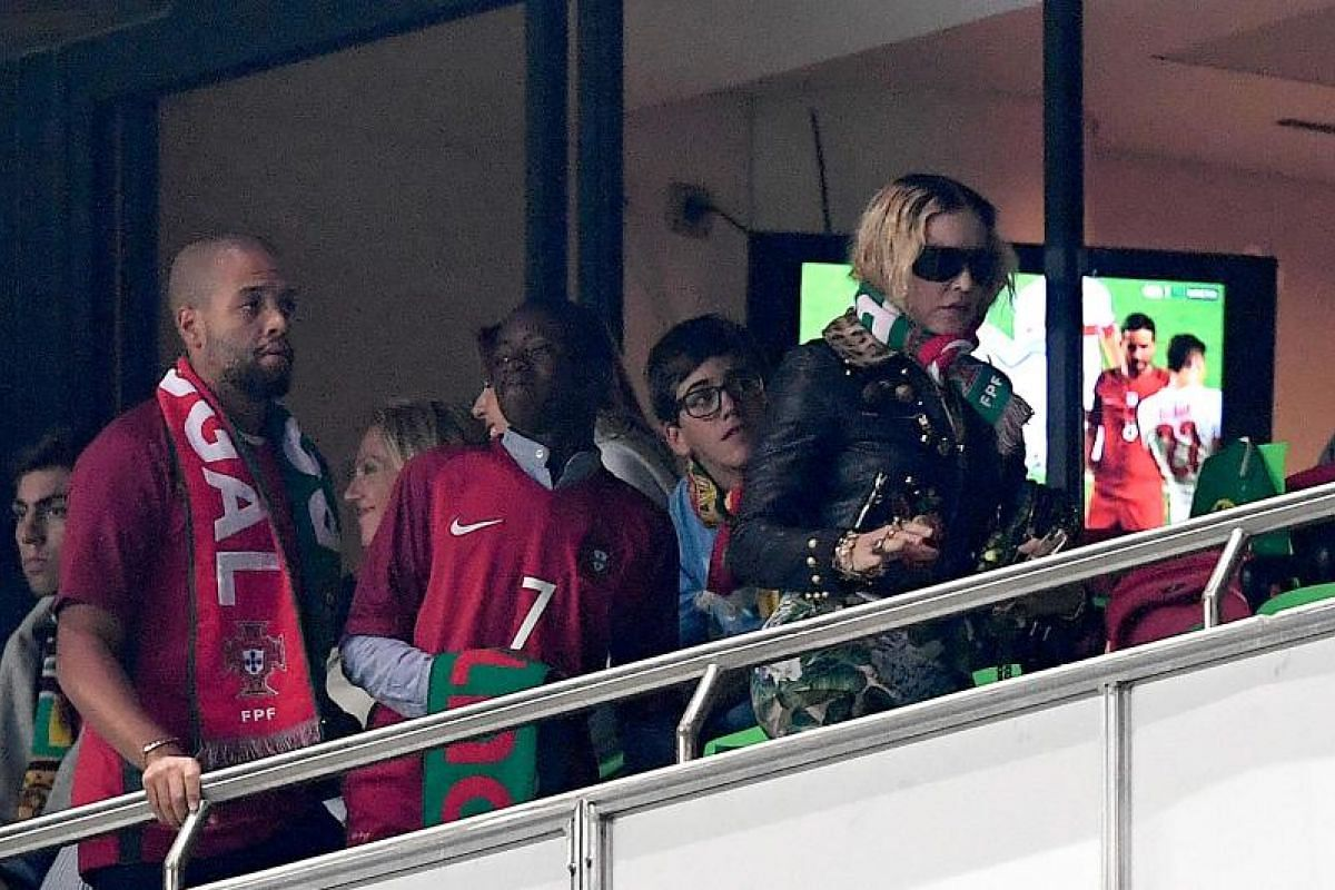 American pop star Madonna and her son David Banda attending the match between Portugal and Switzerland at the Luz Stadium in Lisbon.