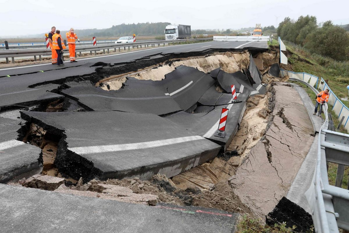 Experts inspect an unexplained landslide in northern Germany, Oct 10, 2017. PHOTO: AFP