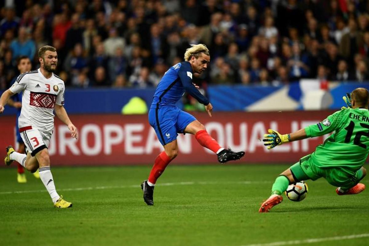France forward Antoine Griezmann shooting and scoring during the qualifier between France and Belarus at the Stade de France in Paris. The hosts won 2-1 to seal their berth in Russia.