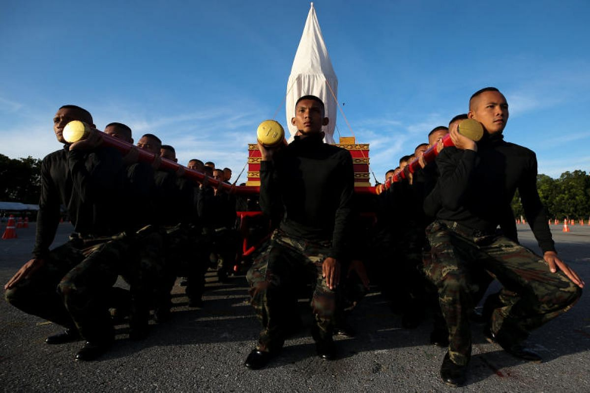 Army officers rehearsing their part in the funeral ceremony.
