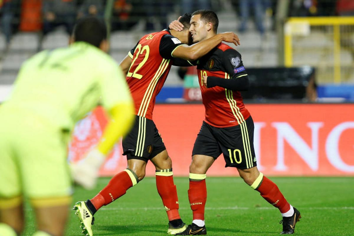 Belgium forward Eden Hazard (right) celebrating his opener against Cyprus with Nacer Chadli. They won 4-0.