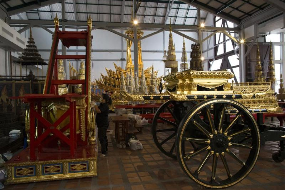 A Thai worker putting the finishing touches on the royal funeral preparations at the National Museum in Bangkok.