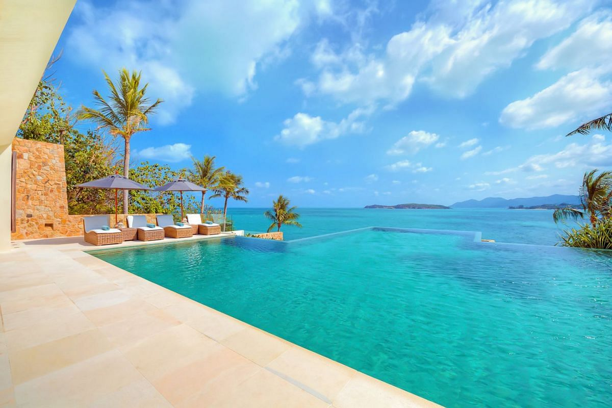 The infinity pool and view from one of Samujana's 27 villas in Koh Samui.