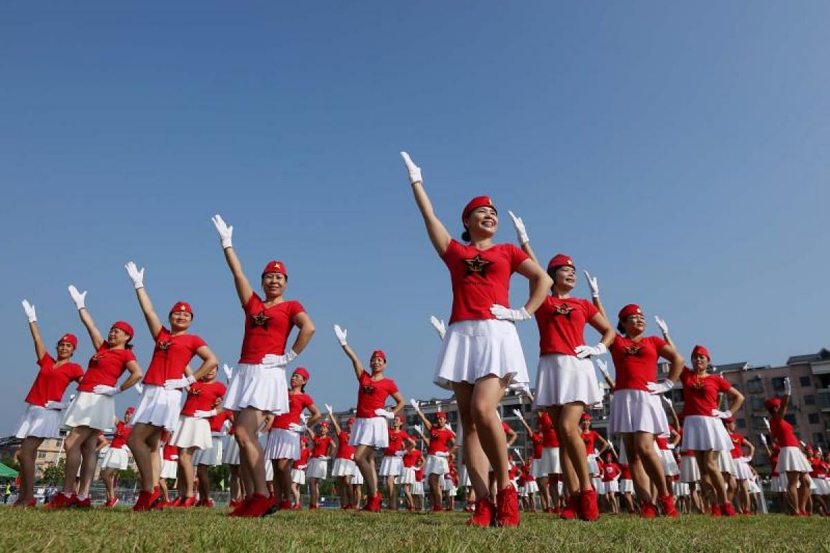 Dancers posing in formation to celebrate the upcoming Party Congress, in Rongan in China's southern Guangxi region on Oct 8, 2017.