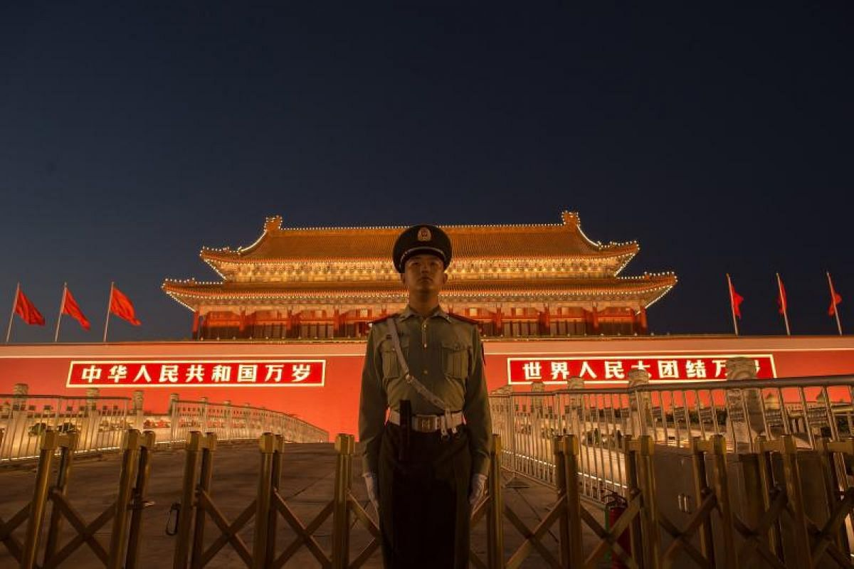 A Chinese paramilitary police officer securing the front gate of the Forbidden City in Beijing on Sept 28, 2017.