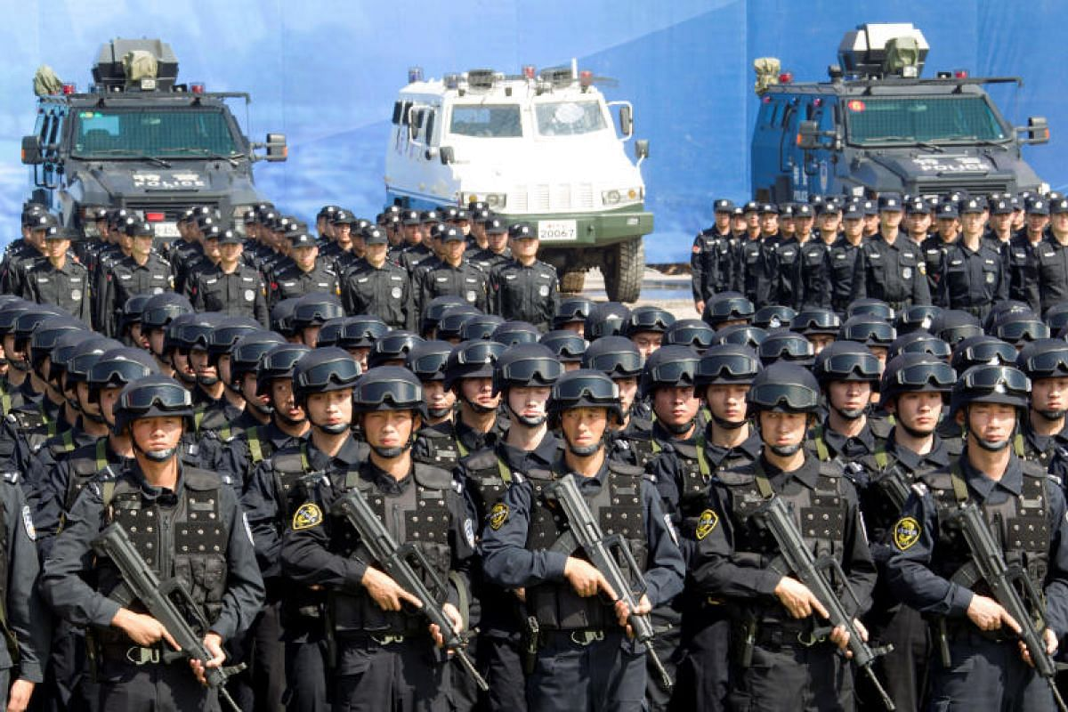 Chinese police officers taking part in a security oath-taking rally for the 19th National Congress of the Communist Party, in Nanjing, Jiangsu province on Sept 27, 2017.