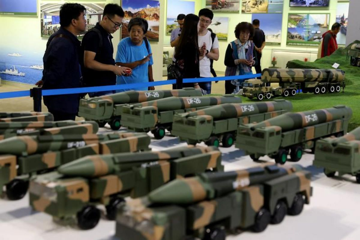 Visitors viewing models of Chinese military equipment during an exhibition showcasing China's achievements over the past five years at the Beijing Exhibition Hall on Sept 28, 2017.