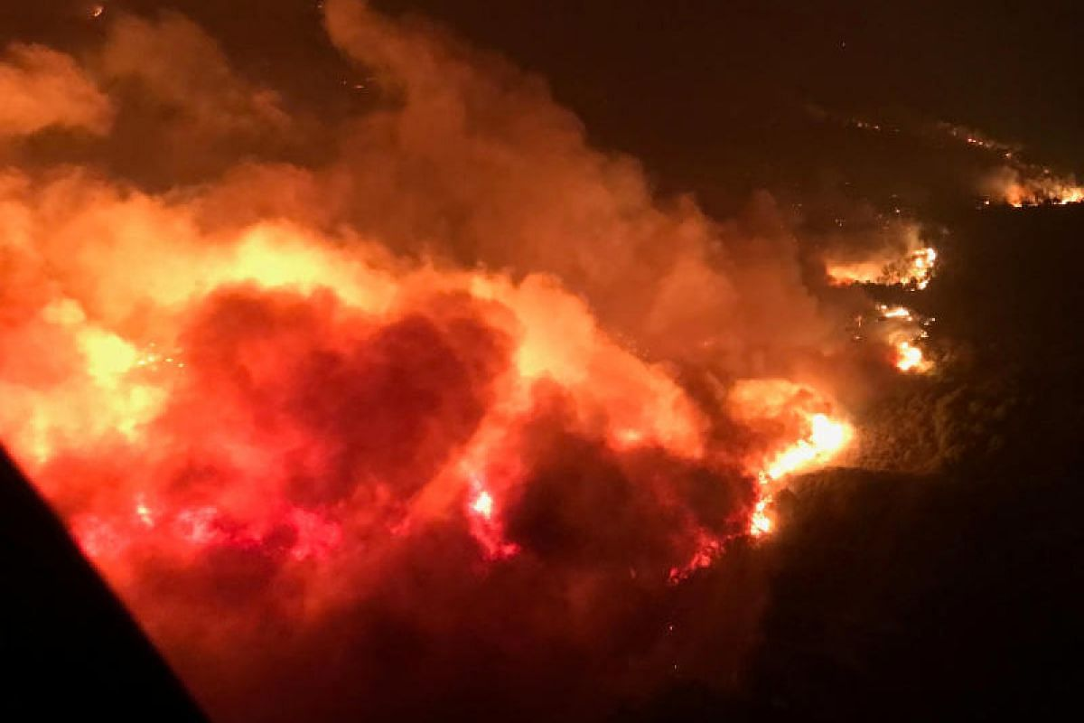 A wildfire is shown from the air near Atlas Road during an operation to rescue people trapped by wildfire in Napa, California on Oct 9.