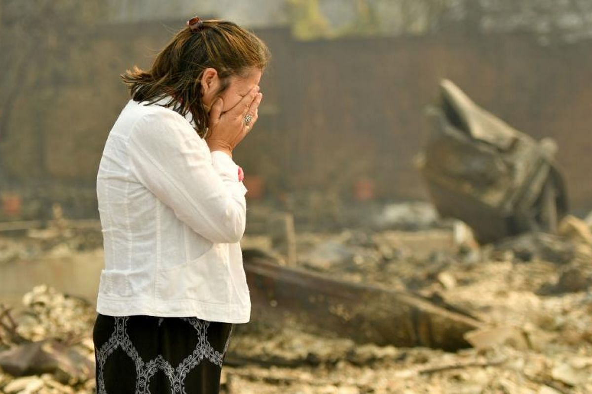 Homeowner Martha Marquez looking over her burned home in Santa Rosa, California on Oct 10.