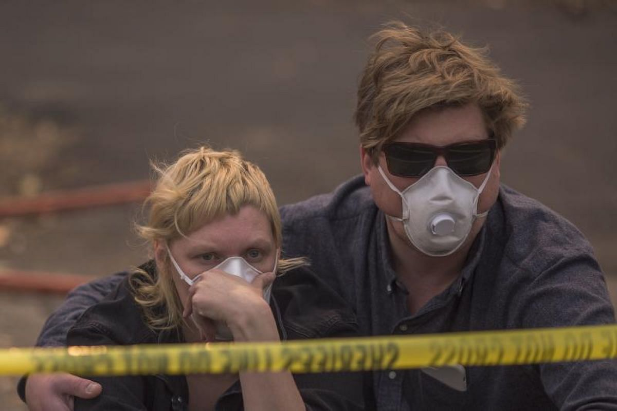 A couple waiting in vain on Oct 11 to be escorted to pick up possessions from their home inside an evacuation zone in Napa.