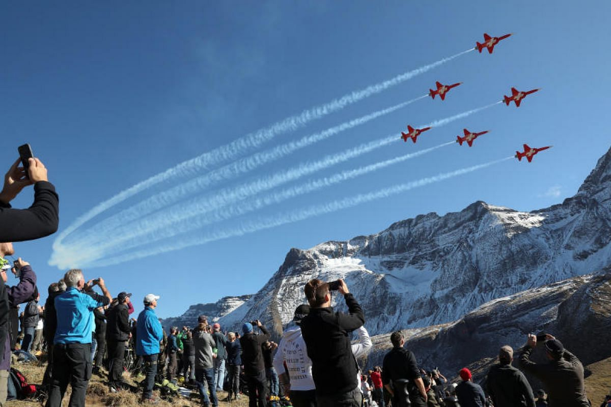 Members of the Patrouille Suisse performing in their Swiss Air Force Northrop F-5E Tiger II fighter jets during a flight demonstration of the Swiss Air Force over the Axalp in the Bernese Oberland, Switzerland on October 12, 2017.