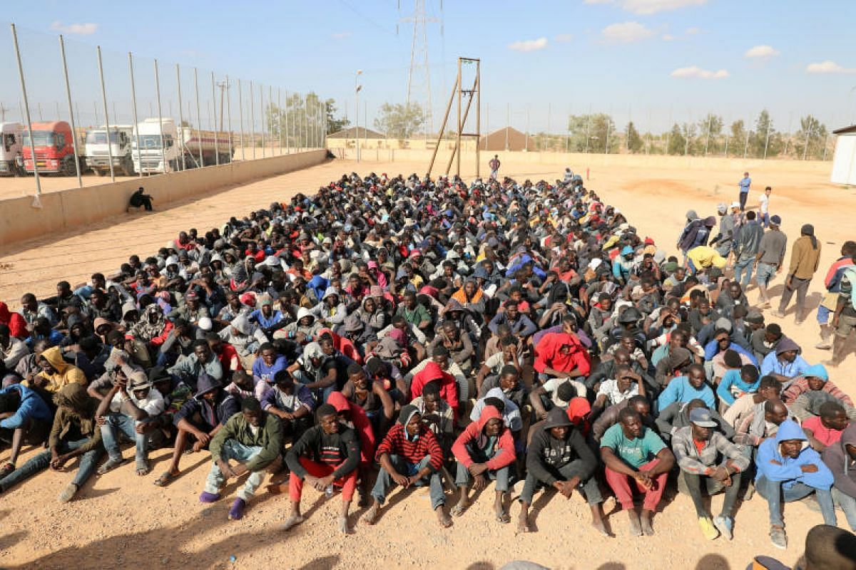 Migrants sitting at a detention centre in Gharyan, Libya on Oct 12, 2017.