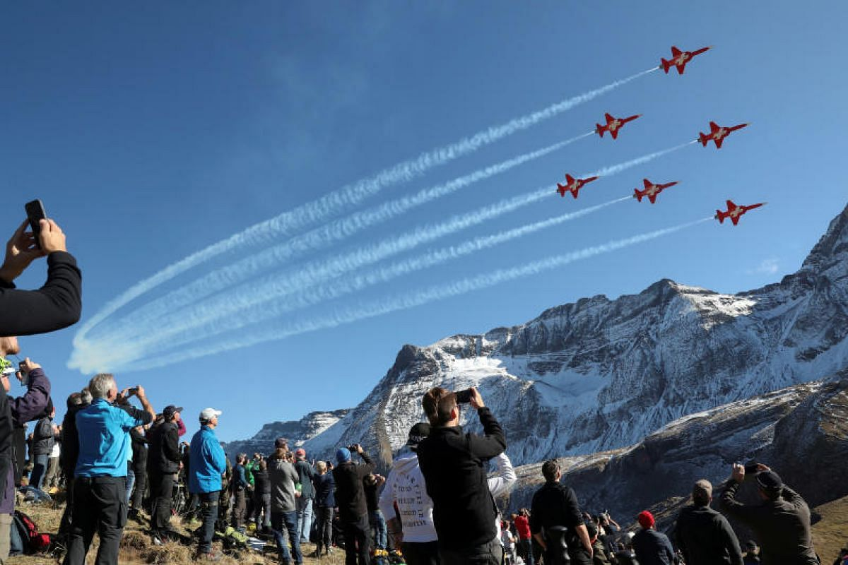 Members of the Patrouille Suisse performing in their Swiss Air Force Northrop F-5E Tiger II fighter jets during a flight demonstration of the Swiss Air Force over the Axalp in the Bernese Oberland, Switzerland on Oct 12, 2017.