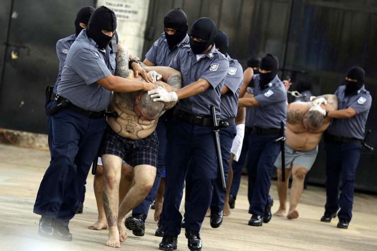 Salvadoran authorities transferring five leaders of the Mara Salvatrucha (MS13) to the top security penitentiary where they will be isolated in San Salvador, El Salvador on Oct 12, 2017. The prisoners are acccused of ordering over 200 murders between