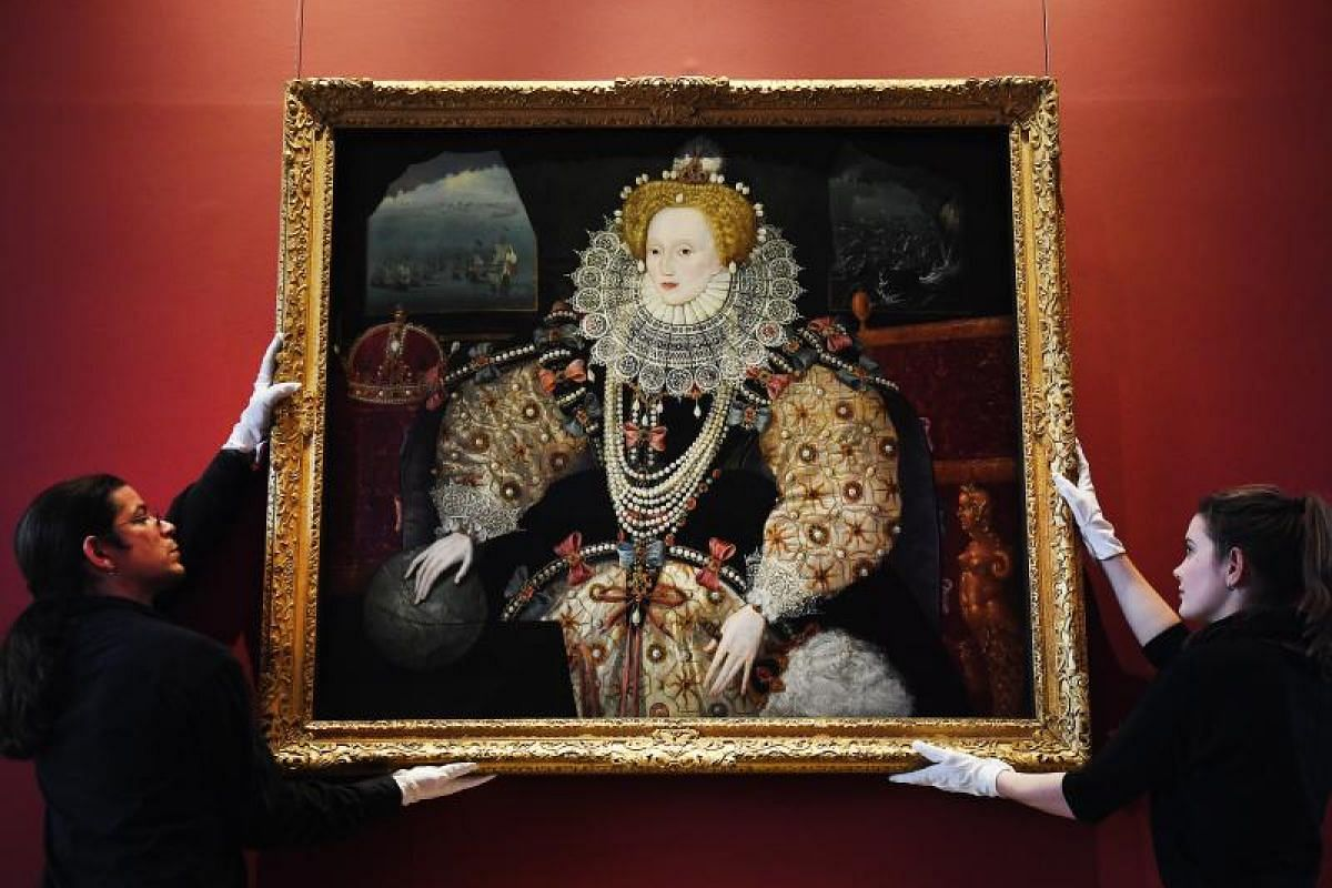 The iconic Armada Portrait of Elizabeth I is being placed at the Queen's House at Greenwich in London Oct 12, 2017. The portrait is one of the earliest examples of a large-scale work in oils by any English painter, with a connection to the two most