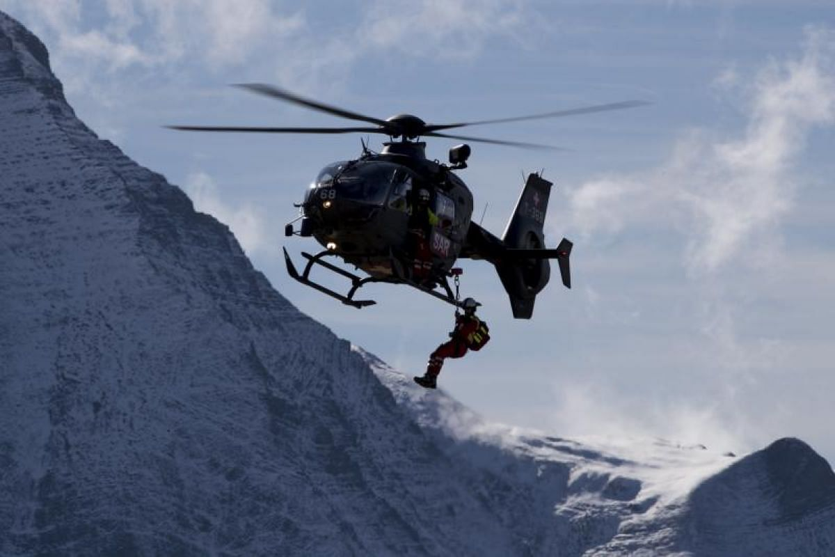 A Eurocopter 635 of the Swiss Air Force demonstrating a rescue mission in the Swiss Alps on Oct 11, 2017.