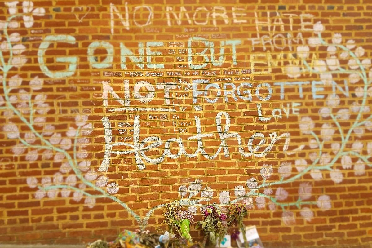 Flowers left at the spot where Ms Heather Heyer was killed on Aug 12 in Charlottesville, Virginia, after a young neo-Nazi slammed his car into a crowd.