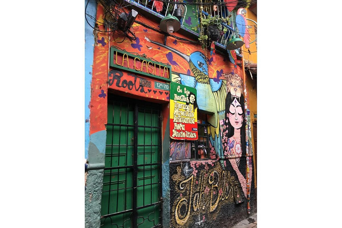 La Candelaria in Colombia is lined with buildings decorated by colourful graffiti.