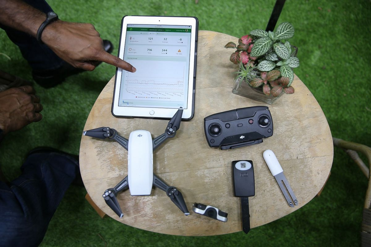 Mr Veera Sekaran of Greenology has created a network of sensors (above) that can wirelessly send information about the environment to a mobile or tablet device. ST PHOTOS: ONG WEE JIN