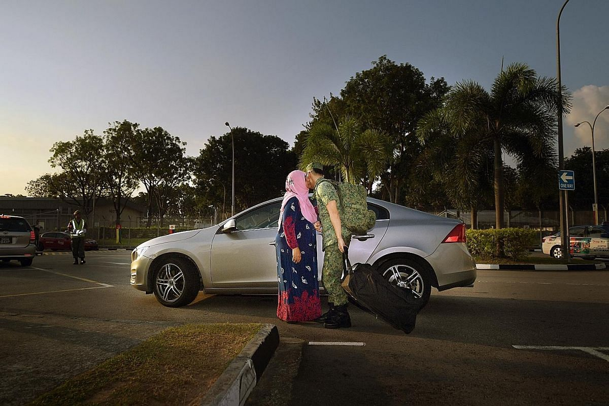 Corporal First Class (NS) Muhammad Asri, 26, a sales executive at an engineering company, says goodbye to his mother, Madam Rosmiati Hambali, 52, outside Jurong Camp II. CFC (NS) Muhammad is an assistant layer with a mortar team in the 746th Battalio