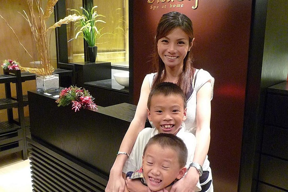 Ms Cheryl Gan as a toddler (above) in an undated photograph. Ms Gan with her two oldest children - Nicholas (centre), then eight, is now 15; while Nigel (bottom), then seven, is now 14.