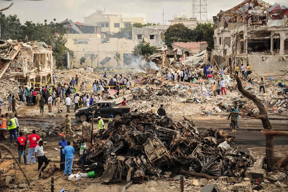 A picture taken on October 15, 2017 shows a general view of the scene of the explosion of a truck bomb in the centre of Mogadishu. A truck bomb exploded outside a hotel at a busy junction in Somalia's capital Mogadishu on October 14, 2017 causing wid