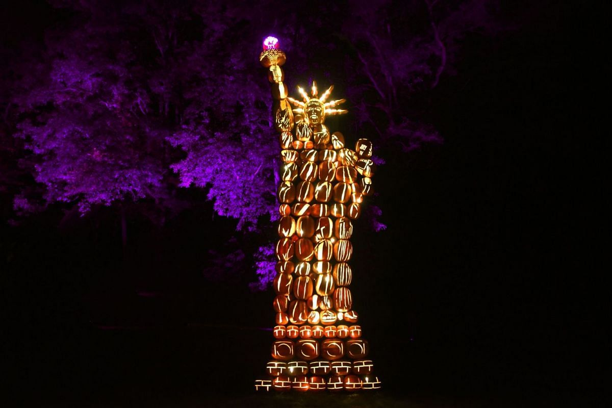 Illuminated pumpkins in the shape of the Statue of Liberty are on display during the Great Jack O'Lantern Blaze at Van Cortlandt Manor in Croton-on-Hudson, New York, on October 14, 2017. The Great Jack O'Lantern Blaze is for 45 evenings, including