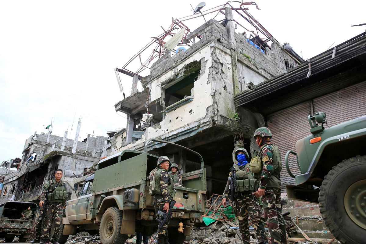 Government troops carrying out clearing operations on Sept 13, 2017, against pro-ISIS militants who had seized Mapandi district in Marawi city, southern Philippines.