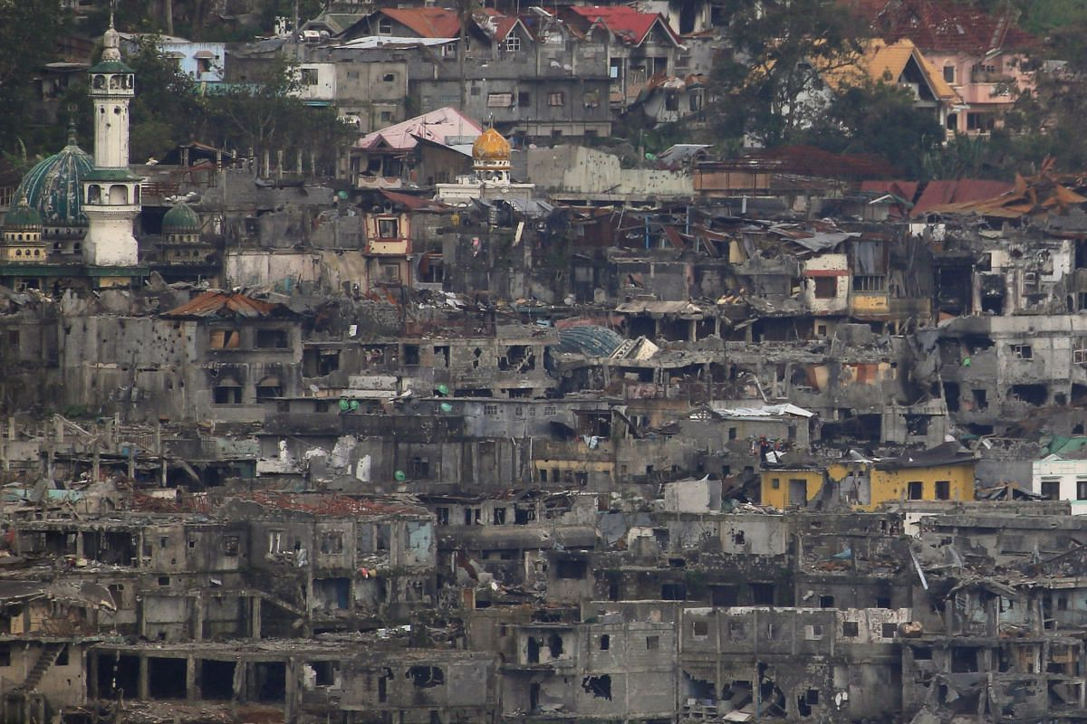 Damaged buildings and houses on Sept 11, 2017, as government troops continue their assault during clearing operations against pro-ISIS militants group which have seized control over large parts of Marawi City.