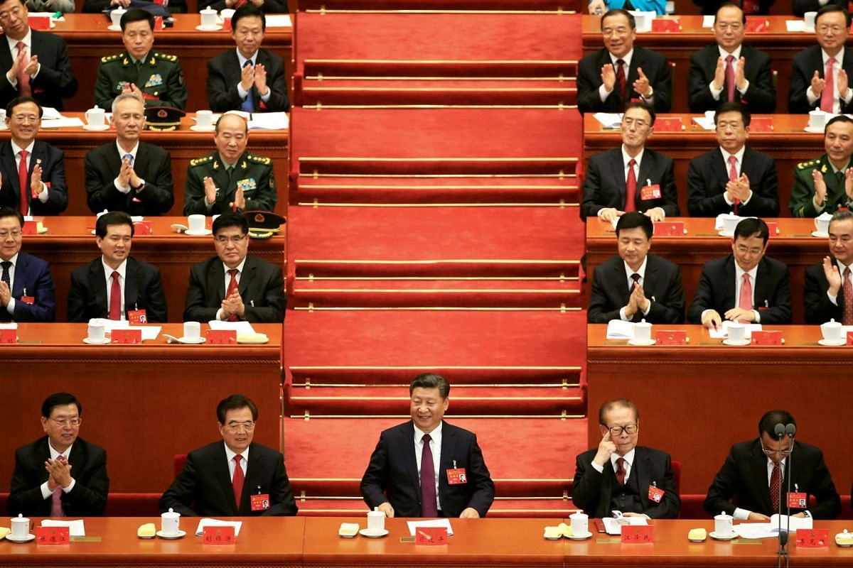 Front row, from left: Chairman of the Standing Committee of the National People's Congress Zhang Dejiang, former Chinese President Hu Jintao, Chinese President Xi Jinping, former President Jiang Zemin, and Chinese Premier Li Keqiang, at the opening o