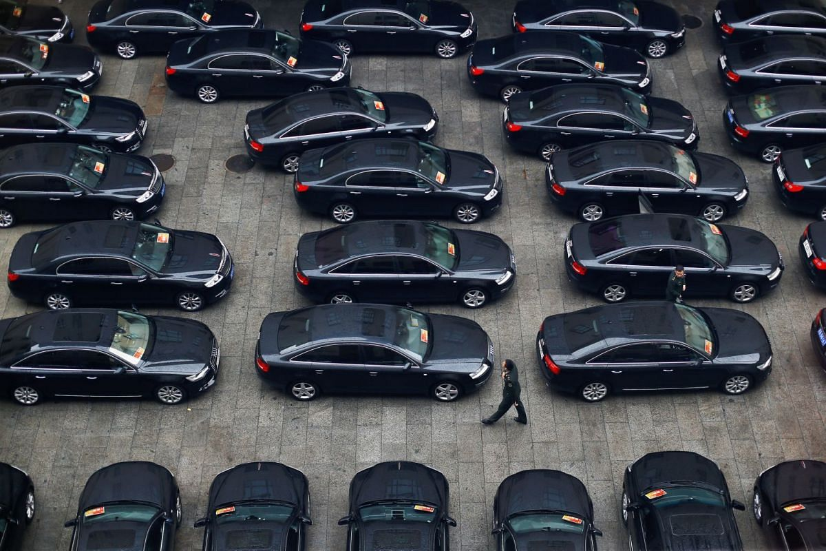 Cars are parked at the Great Hall of the People during the opening session of the 19th National Congress of the Communist Party of China in Beijing on Oct 18, 2017.
