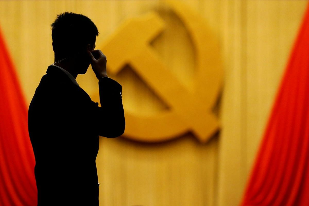 A security agent taking position at the Great Hall of the People during the opening session of the 19th National Congress of the Communist Party of China in Beijing on Oct 18, 2017.