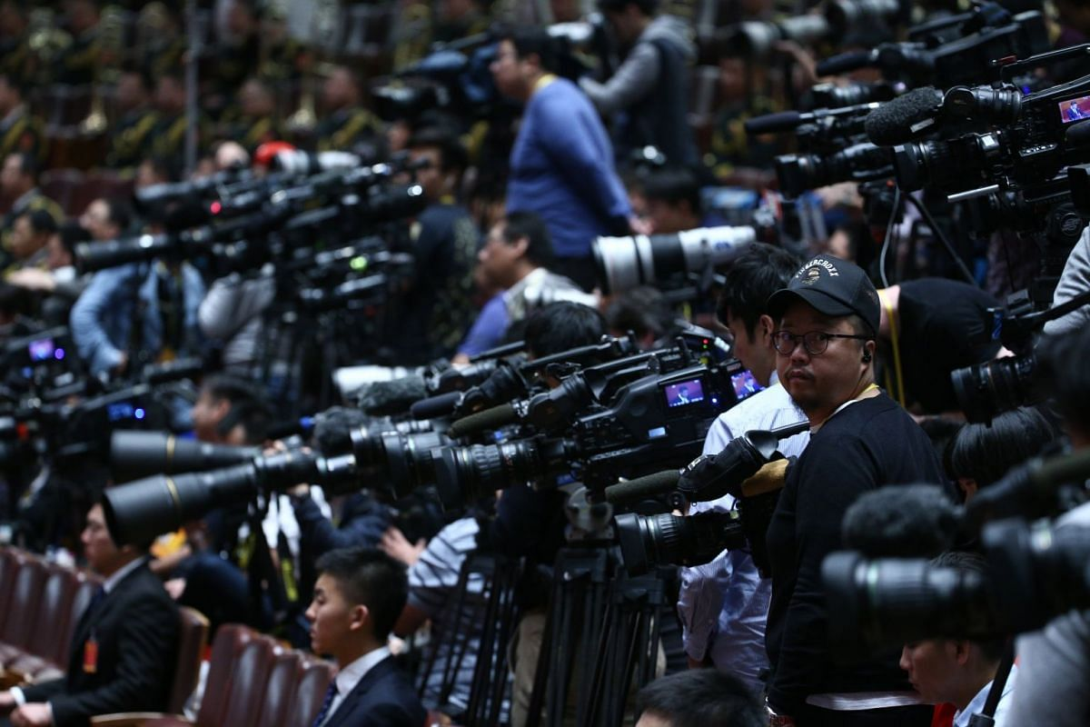 Members of the media are seen during the opening ceremony of the 19th National Congress of the Communist Party of China at the Great Hall of the People in Beijing on Oct 18, 2017.