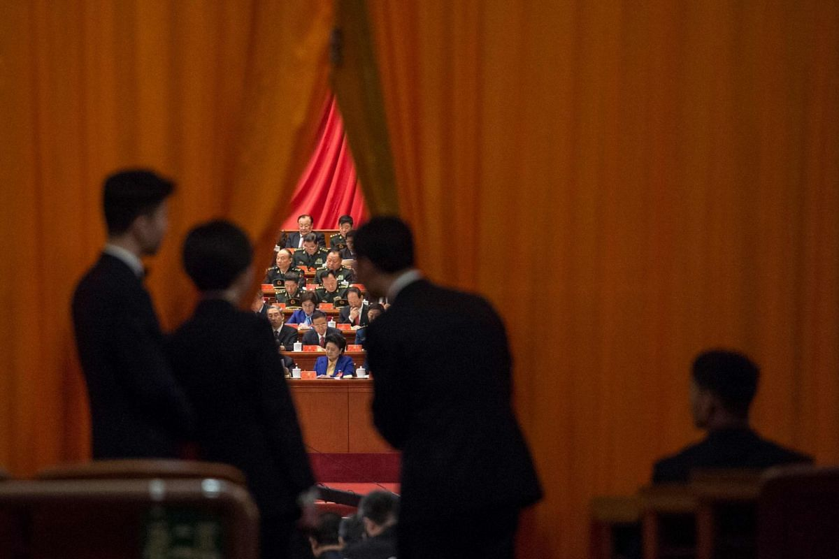Chinese security guards looking at military delegates during the speech of Chinese President Xi Jinping at the Communist Party's 19th Congress in Beijing on Oct 18, 2017.