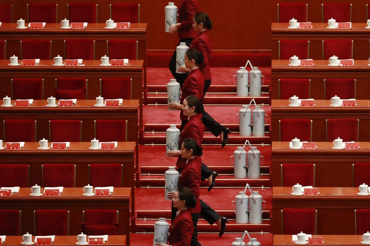 Chinese stewardesses preparing tea flasks for delegates before the opening ceremony of the 19th National Congress of the Communist Party of China at the Great Hall of the People in Beijing on Oct 18, 2017.