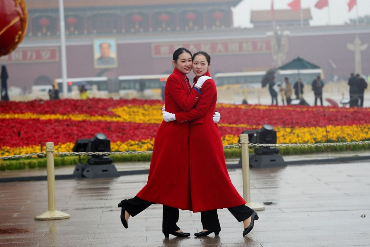 Ushers posing for photos at Tiananmen Square during the opening of the 19th National Congress of the Communist Party of China at the Great Hall of the People in Beijing on Oct 18, 2017.