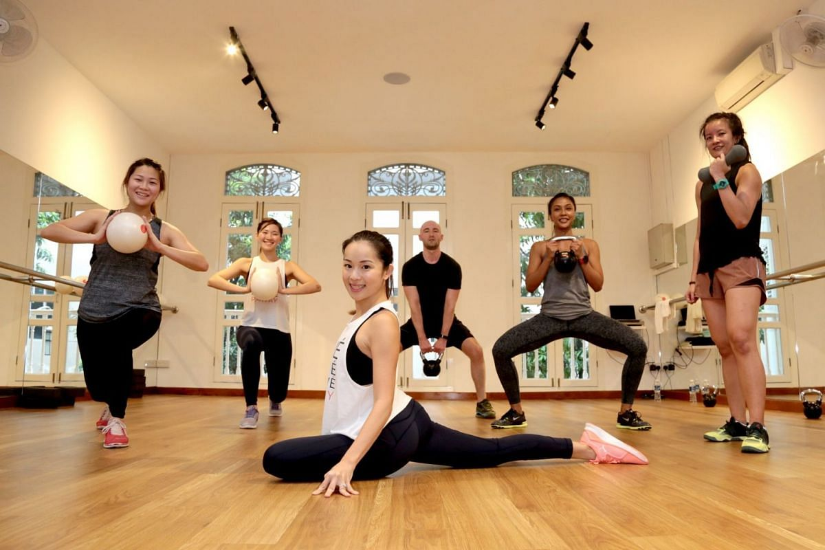 Founder of barre studio WeBarre, Ms Anabel Chew (centre, in white top), with her students (from left) Diana Hioe, Goh Shuxian, Matthew Doube, Lizawati Muhammad Sarif, and Lock Hui Ting. WeBarre has been offering 40-minute WeBarre Hiit classes at her