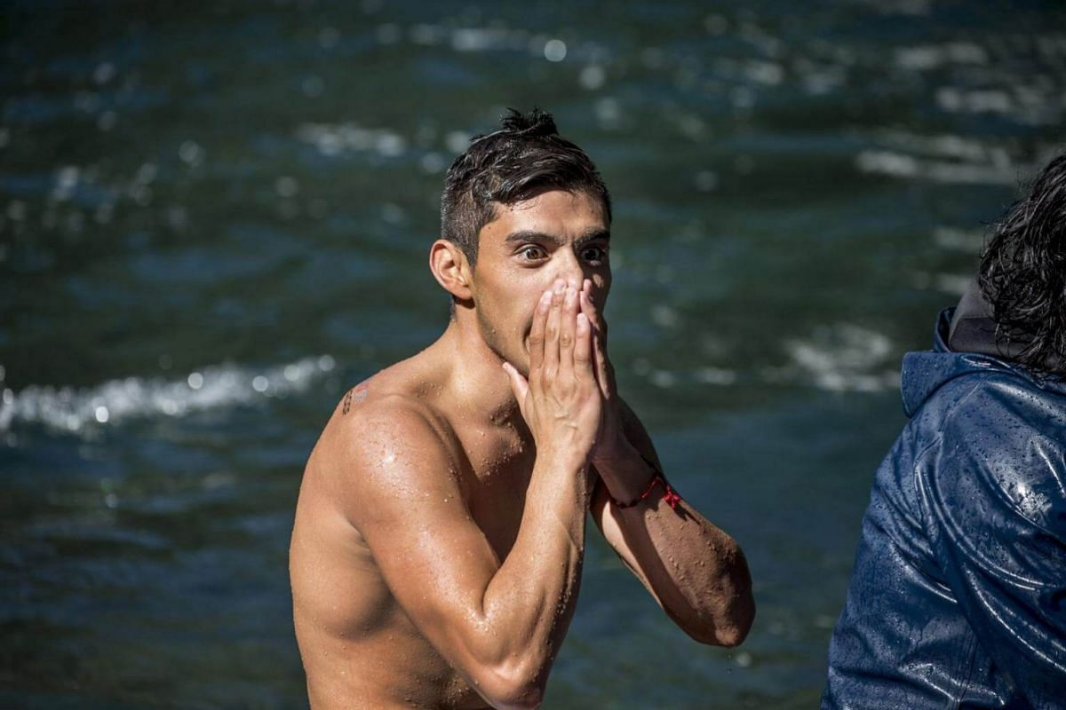 Jonathan Paredes of Mexico celebrating winning the men's championship at the world series of Red Bull Cliff Diving, in Saltos de Rininahue, Chile, on Oct 21, 2017.